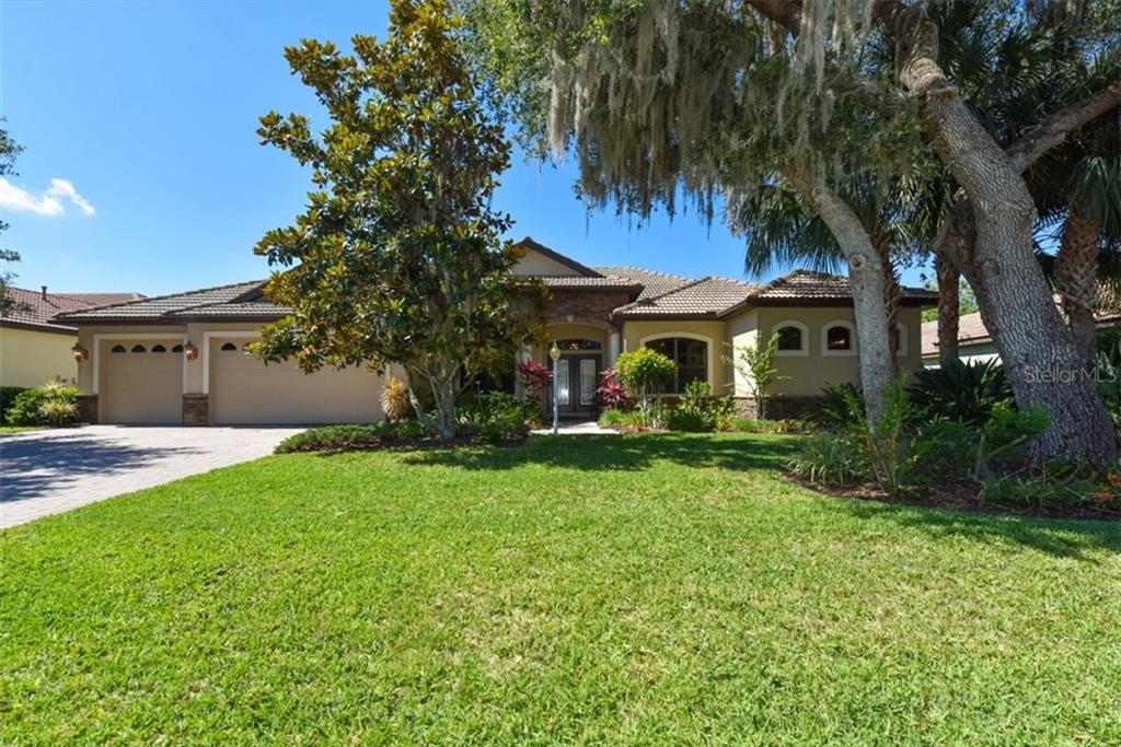 Brick pavers in driveway, tile roof, mature landscaping, 3 car garage, economical well for irrigation. - Single Family Home for sale at 4851 Sweetshade Dr, Sarasota, FL 34241 - MLS Number is A4186306