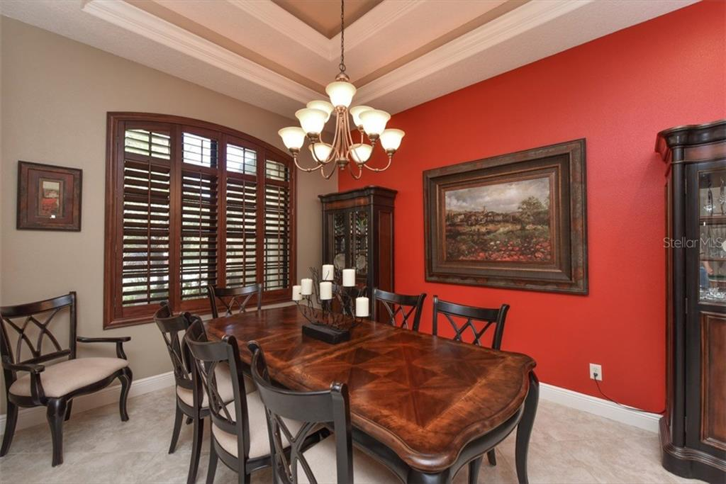 DR with plantation shutters and tray ceiling. - Single Family Home for sale at 4851 Sweetshade Dr, Sarasota, FL 34241 - MLS Number is A4186306