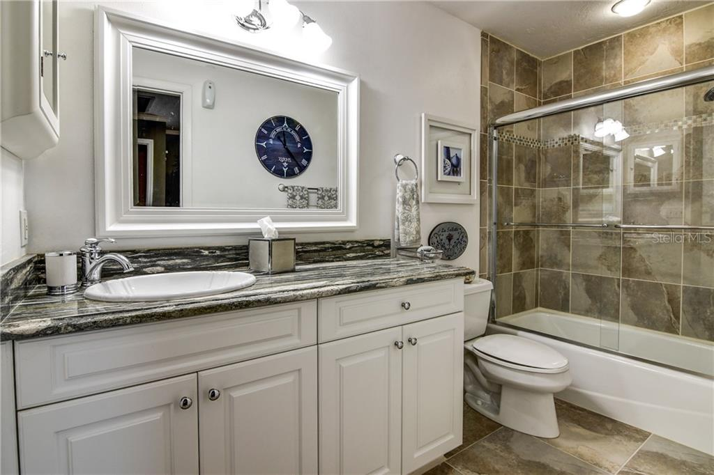 Ensuite bath for second bedroom. - Single Family Home for sale at 8916 44th Avenue Dr W, Bradenton, FL 34210 - MLS Number is A4186449
