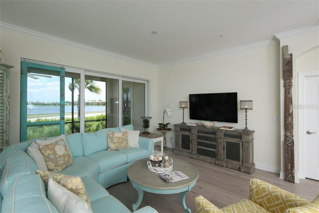 Family room. - Condo for sale at 1255 Riverscape St #n/A, Bradenton, FL 34208 - MLS Number is A4186832