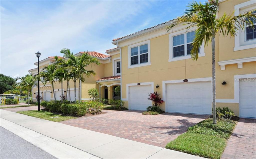Front exterior - Condo for sale at 81 Navigation Cir #103, Osprey, FL 34229 - MLS Number is A4188370