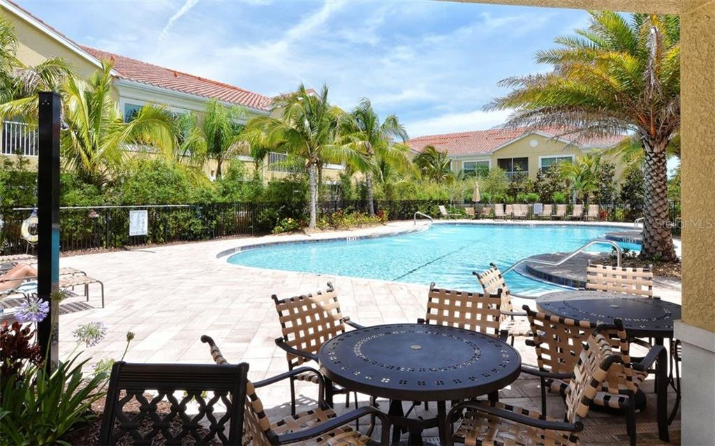 Community swimming pool - Condo for sale at 81 Navigation Cir #103, Osprey, FL 34229 - MLS Number is A4188370