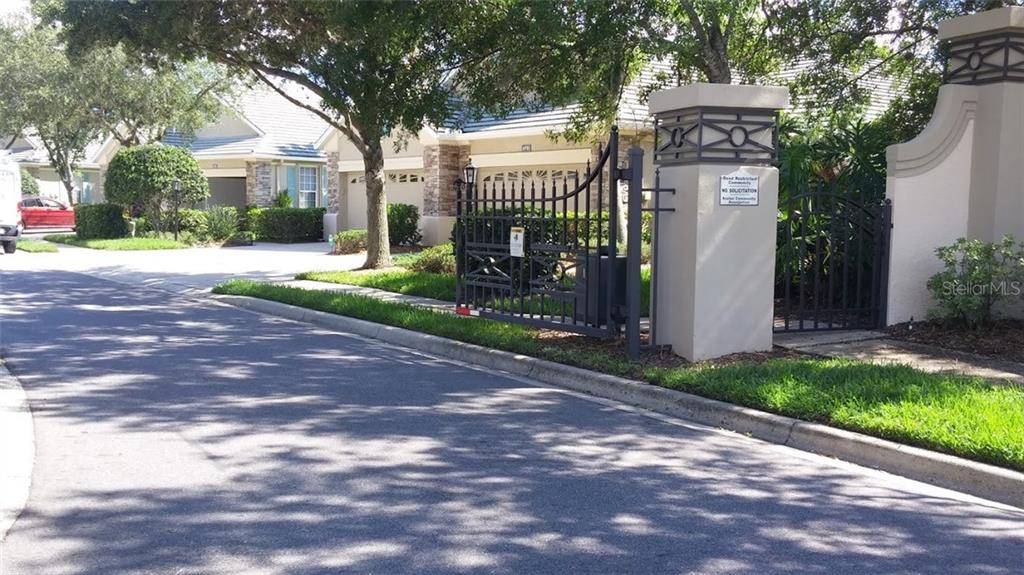The gates provide security and prestige to this well-manicured neighborhood. - Villa for sale at 6953 Mystic Ln, Sarasota, FL 34243 - MLS Number is A4188738