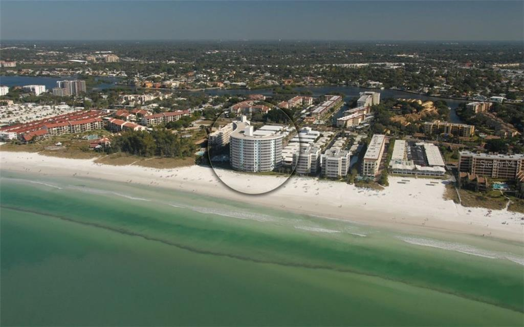 Aerial view of Crystal Sands looking east - Condo for sale at 6300 Midnight Pass Rd #806, Sarasota, FL 34242 - MLS Number is A4189340