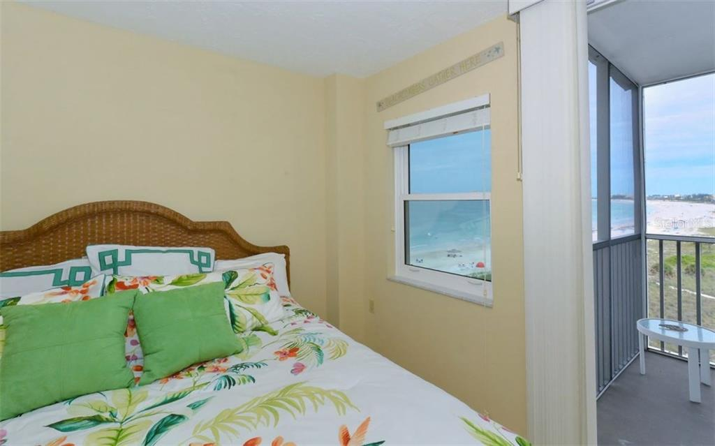 Bedroom 2 with sliders to covered terrace - Condo for sale at 6300 Midnight Pass Rd #806, Sarasota, FL 34242 - MLS Number is A4189340