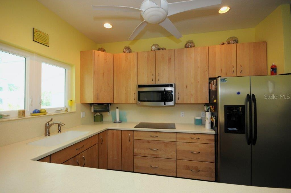 Kitchen with lots of drawers and storage space! - Single Family Home for sale at 3319 Mayflower St, Sarasota, FL 34231 - MLS Number is A4189488