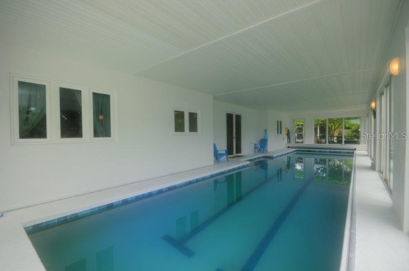 Under-roof swimming pool with lap lanes is 52 feet long, perfect for your daily exercise for people with sun-sensitive skin. Gas heat and motorized cover to keep the heat in make this pool a dream. - Single Family Home for sale at 3319 Mayflower St, Sarasota, FL 34231 - MLS Number is A4189488