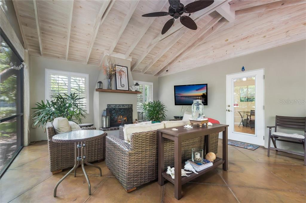 Wood burning Fireplace.  Screened in Porch - Single Family Home for sale at 2516 S Osprey Ave, Sarasota, FL 34239 - MLS Number is A4190729
