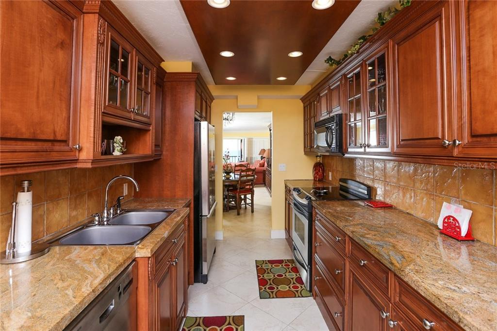 Kitchen with view into Dining area - Condo for sale at 20 Whispering Sands Dr #1103, Sarasota, FL 34242 - MLS Number is A4192663