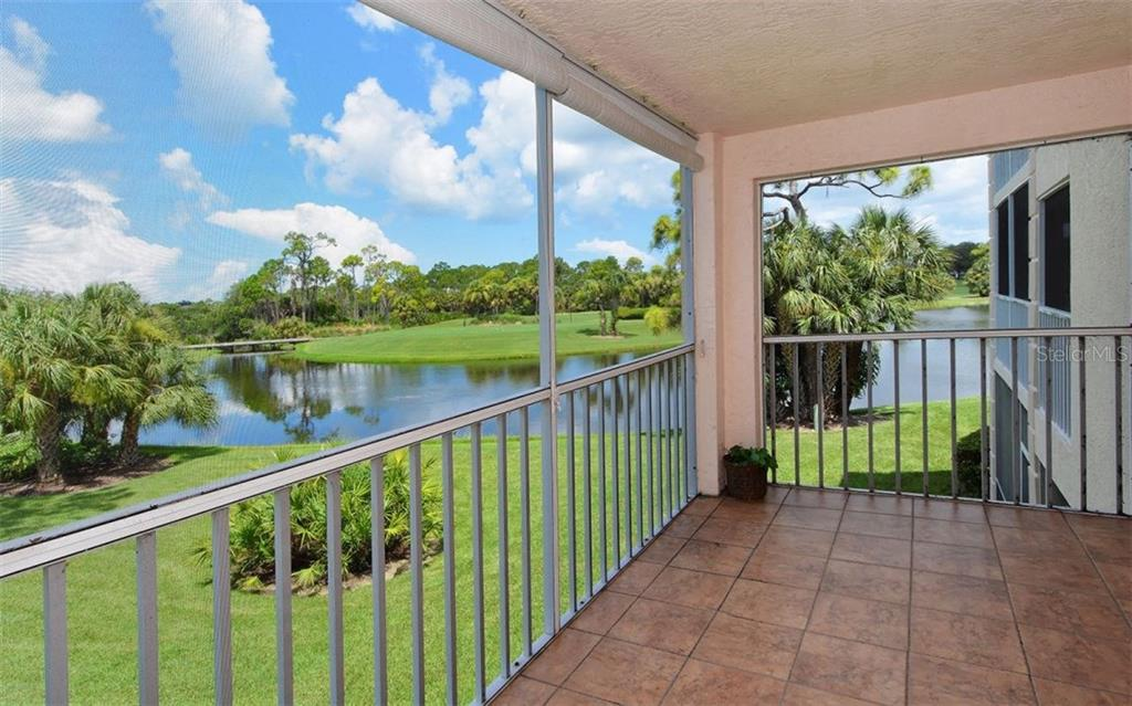 Gorgeous lake, distant golf course views and spectacular sunsets from the screened and tiled lanai of this Stoneybrook Golf & Country Club condo. - Condo for sale at 9300 Clubside Cir #1201, Sarasota, FL 34238 - MLS Number is A4192821