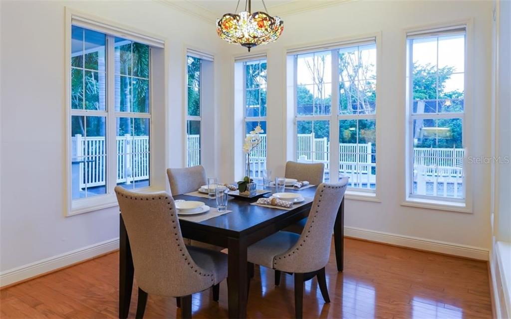 Breakfast nook off of the kitchen area. Tiffany light fixture does not convey. - Single Family Home for sale at 9818 9th Ave Nw, Bradenton, FL 34209 - MLS Number is A4194125