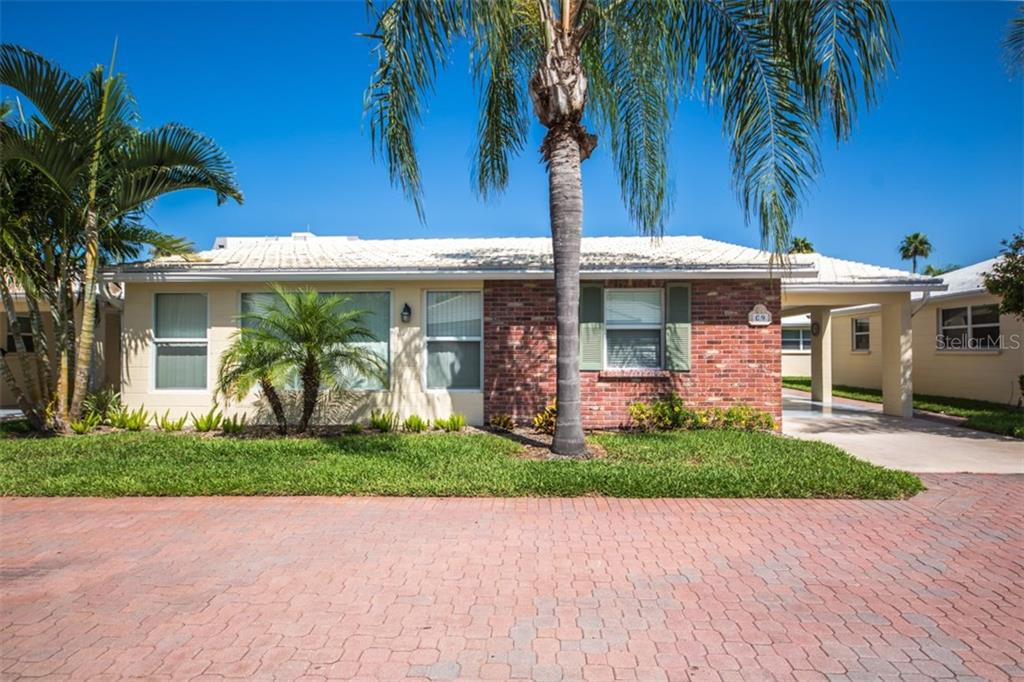 Exterior front view - Condo for sale at 6140 Midnight Pass Rd #c-9, Sarasota, FL 34242 - MLS Number is A4195879