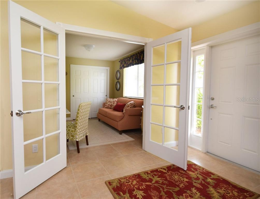 French doors to the Den have privacy shades - Villa for sale at 2127 Burgos Dr, Sarasota, FL 34238 - MLS Number is A4195921