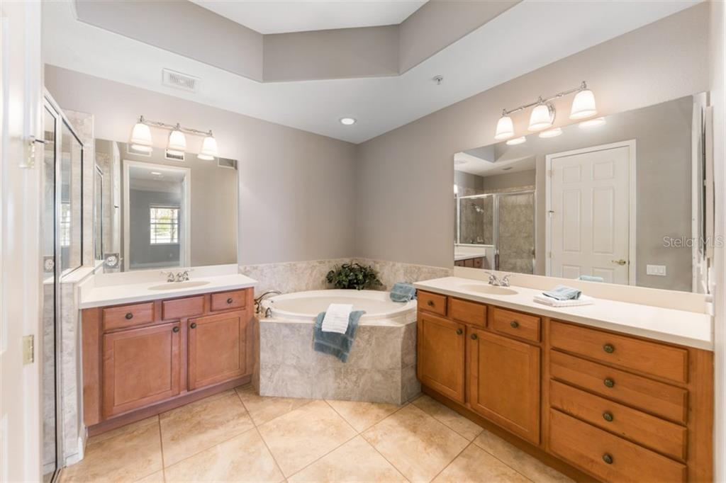 Master bath with tub, separate shower and lots of counter space. - Condo for sale at 6415 Moorings Point Cir #102, Lakewood Ranch, FL 34202 - MLS Number is A4196054