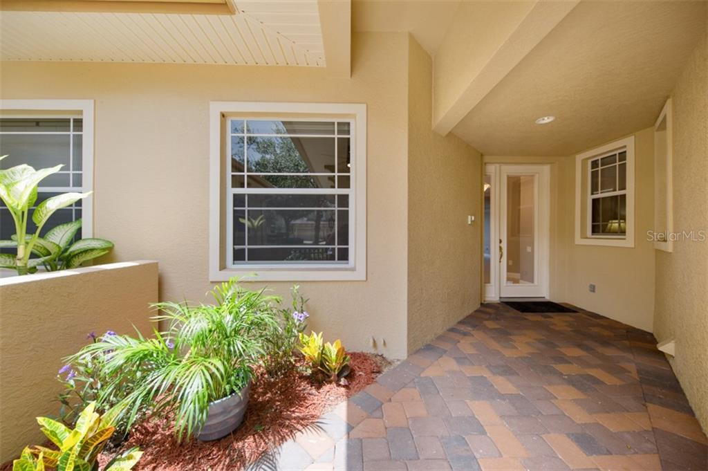 Private courtyard entrance directly into unit. - Condo for sale at 6415 Moorings Point Cir #102, Lakewood Ranch, FL 34202 - MLS Number is A4196054