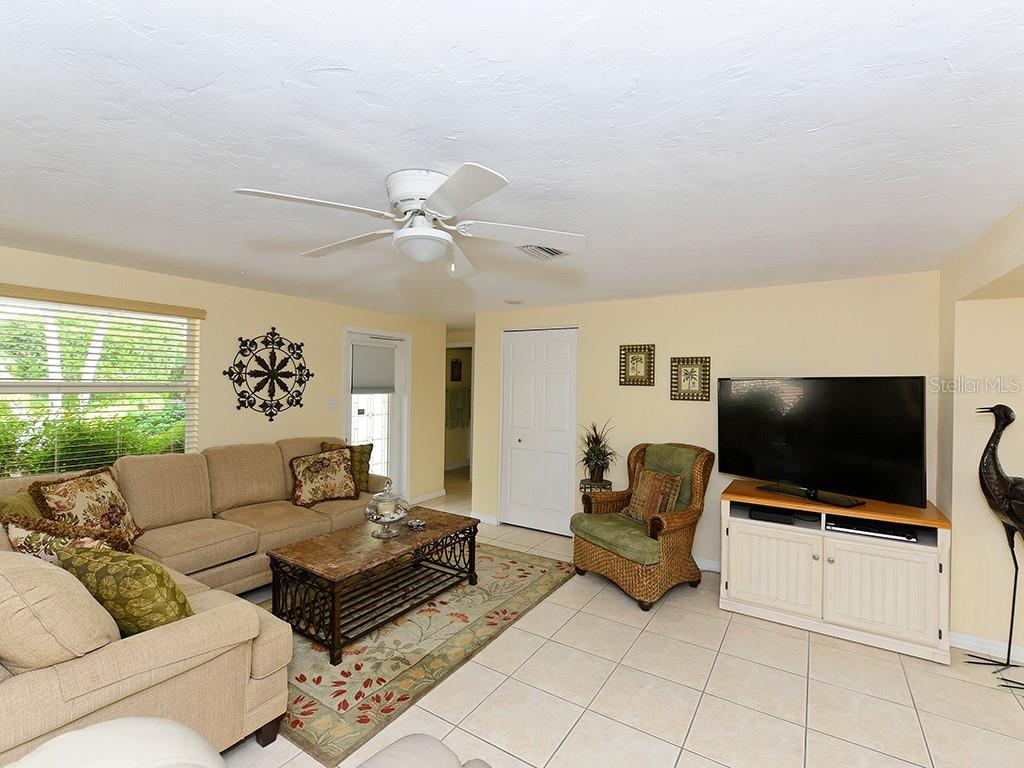 Family room with fireplace - Single Family Home for sale at 726 Jungle Queen Way, Longboat Key, FL 34228 - MLS Number is A4196293