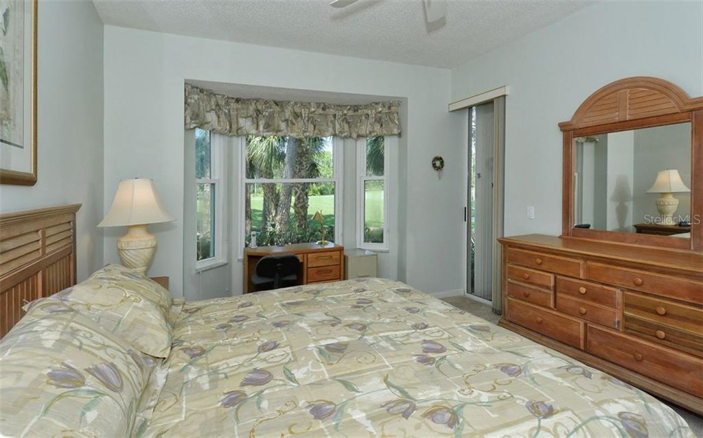 Master bedroom also has a slider to the lanai. - Condo for sale at 9570 High Gate Dr #1712, Sarasota, FL 34238 - MLS Number is A4196327