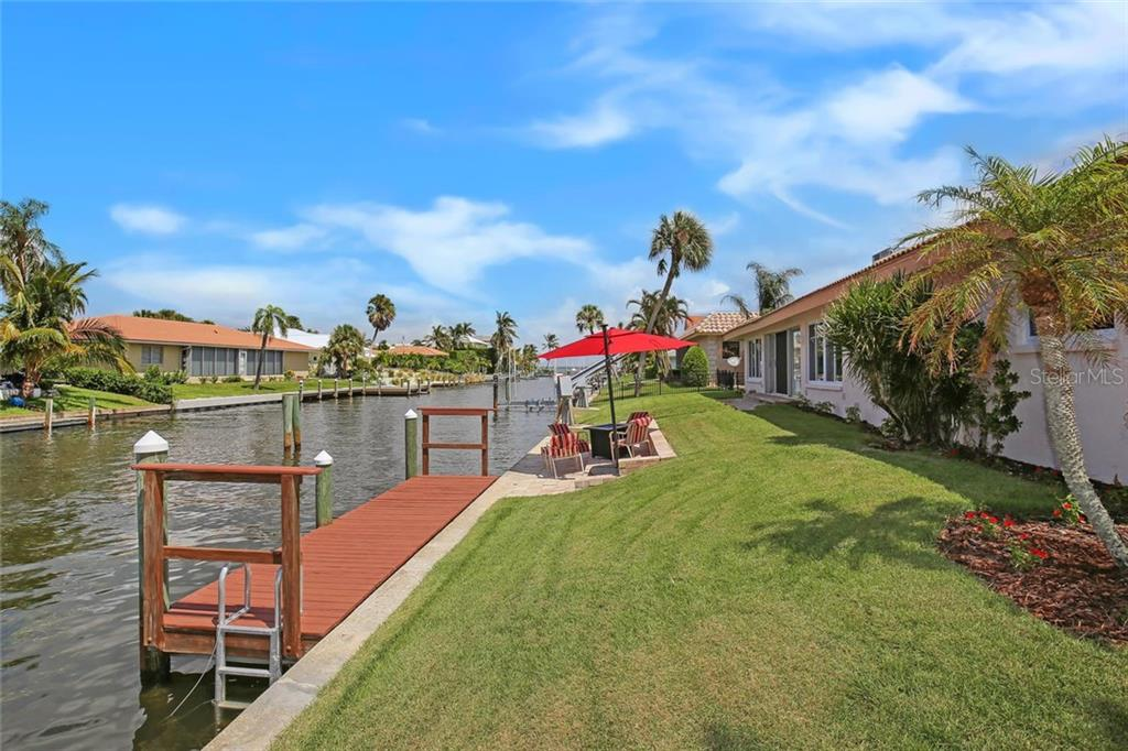 Single Family Home for sale at 541 Putting Green Ln, Longboat Key, FL 34228 - MLS Number is A4196629