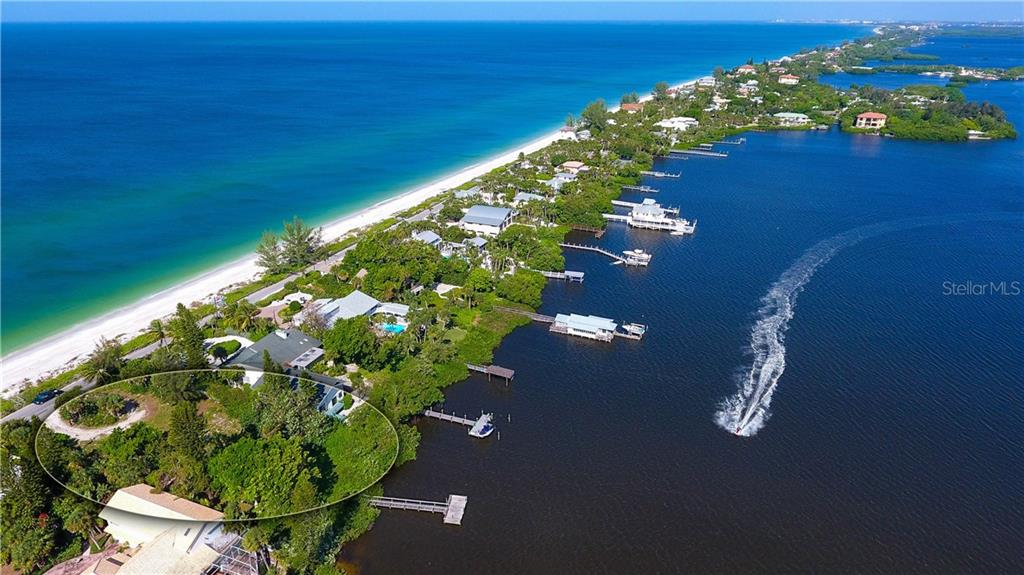 View of this amazing Gulf to Bay lot showing the entire lot with both access points to the water.  Unobstructed view and beach access on the gulf side to never be built on.  Own private dock going onto the beach and another one on the bay ready for your boat! - Vacant Land for sale at 3220 Casey Key Rd, Nokomis, FL 34275 - MLS Number is A4197366