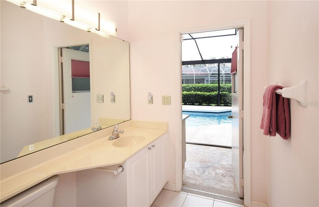 Third Bathroom. Opens out to the pool area - Single Family Home for sale at 9520 Hawksmoor Ln, Sarasota, FL 34238 - MLS Number is A4197662