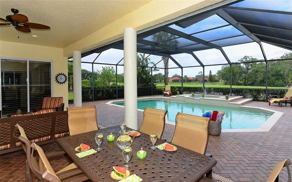 Covered Lanai towards pool - Single Family Home for sale at 9919 Portside Ter, Bradenton, FL 34212 - MLS Number is A4197815