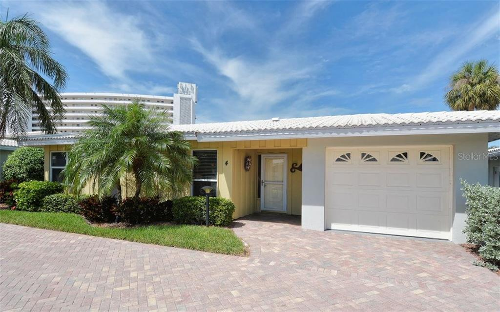 Front exterior - Condo for sale at 6308 Midnight Pass Rd #4, Sarasota, FL 34242 - MLS Number is A4198360