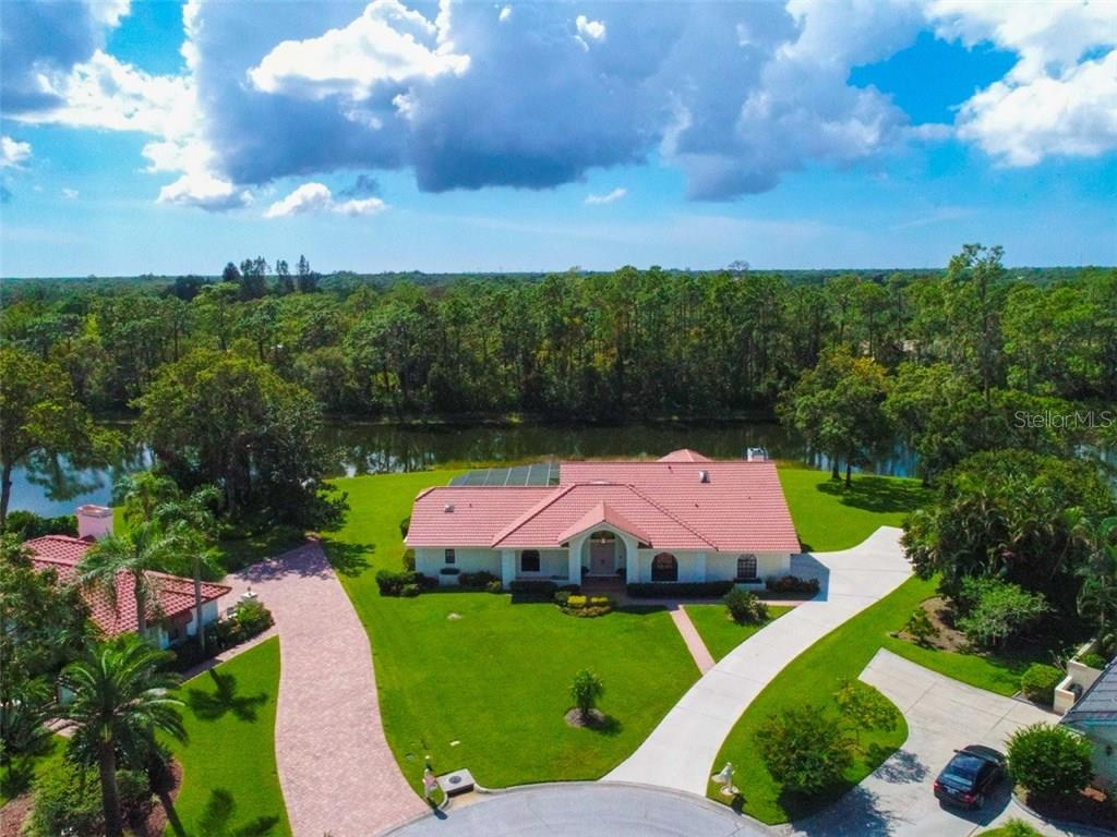 Single Family Home for sale at 7410 Pearlbush Ln, Sarasota, FL 34241 - MLS Number is A4199029