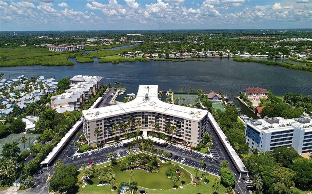 Aerial view of building looking over the Intracoastal Waterway - Condo for sale at 5855 Midnight Pass Rd #328, Sarasota, FL 34242 - MLS Number is A4200358