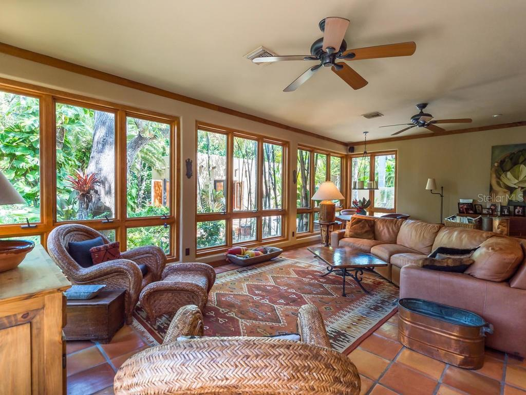 Family room with French doors to outside - Single Family Home for sale at 7340 Pine Needle Rd, Sarasota, FL 34242 - MLS Number is A4200855