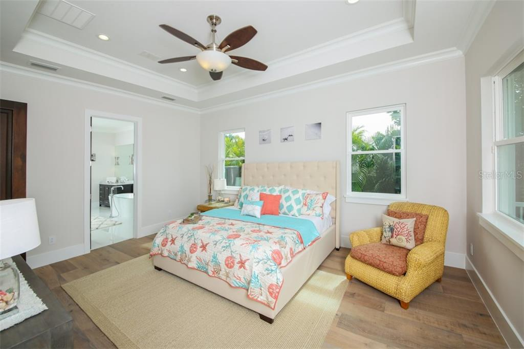 White oak plank floors & waterviews compliment the first floor master suite - Single Family Home for sale at 620 Key Royale Dr, Holmes Beach, FL 34217 - MLS Number is A4200888