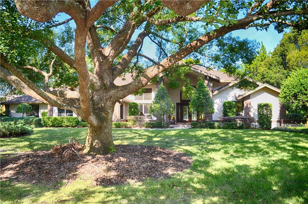 Beautiful Curb appeal, the over-size 3 car garage is side-load, so out of view from the front - Single Family Home for sale at 7529 Weeping Willow Blvd, Sarasota, FL 34241 - MLS Number is A4201676