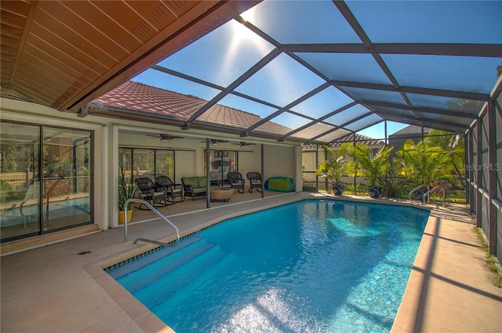 Screen Salt Water Pool and Covered Patio - Single Family Home for sale at 1087 Hoover Cir, Nokomis, FL 34275 - MLS Number is A4201722