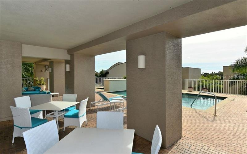 Relaxation area off the pool - Condo for sale at 1771 Ringling Blvd #609, Sarasota, FL 34236 - MLS Number is A4201774