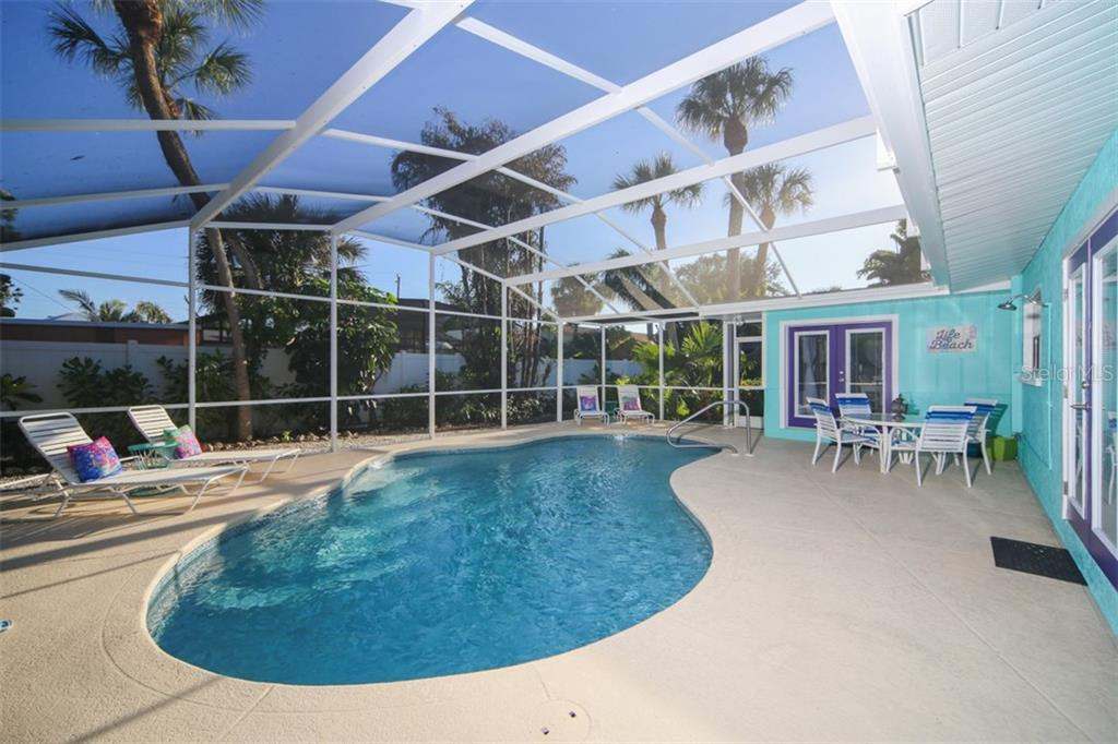 Walk out to the pool from master bedroom and dining room - Single Family Home for sale at 213 70th St, Holmes Beach, FL 34217 - MLS Number is A4202171
