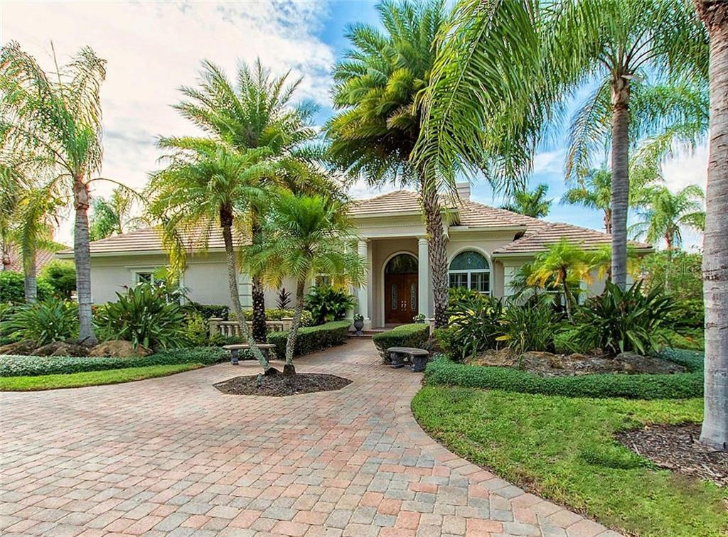 This custom built, estate home is the former model for Pruett Builders of Sarasota, winner of the Grand Aurora Award in 2007. - Single Family Home for sale at 7918 Sloane Gardens Ct, University Park, FL 34201 - MLS Number is A4202335