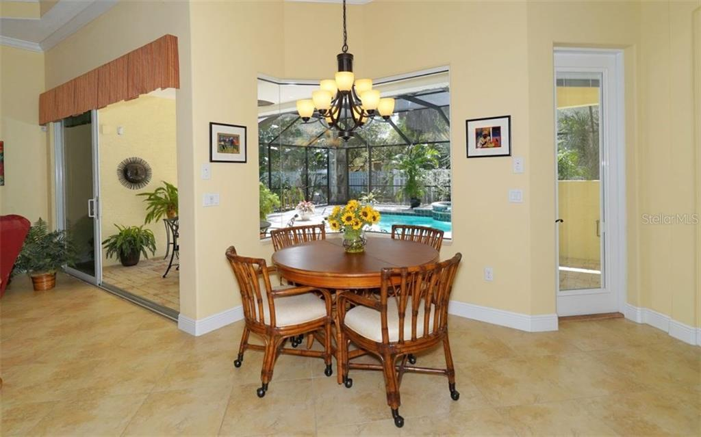 Breakfast area with aquarium glass window - Single Family Home for sale at 1746 Hillview St, Sarasota, FL 34239 - MLS Number is A4202985
