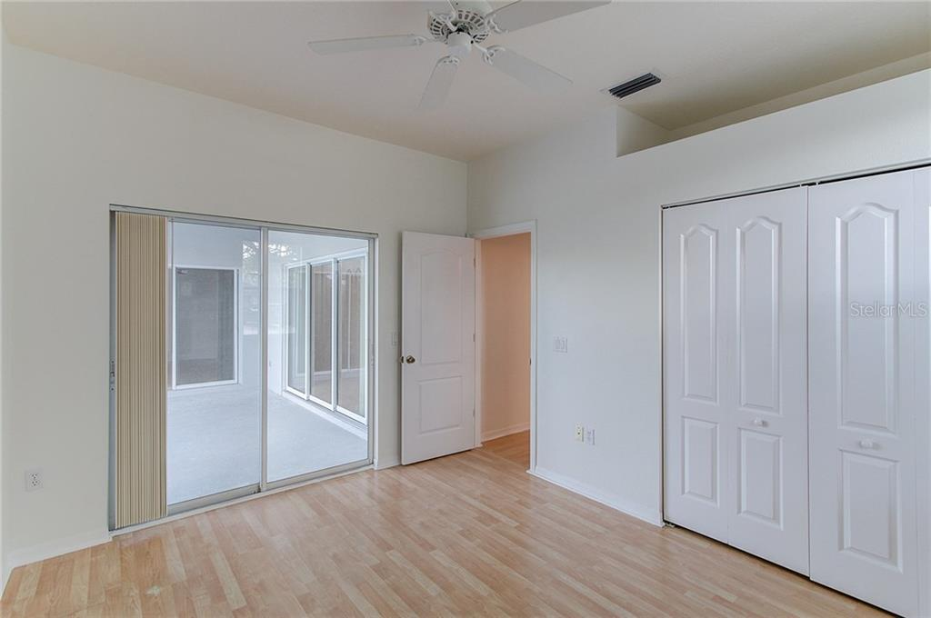 Master Bedroom looking out to Lanai. Sliders to 2nd Bedroom & Living Room visible beyond - Single Family Home for sale at 530 Hunter Ln, Bradenton, FL 34212 - MLS Number is A4203433