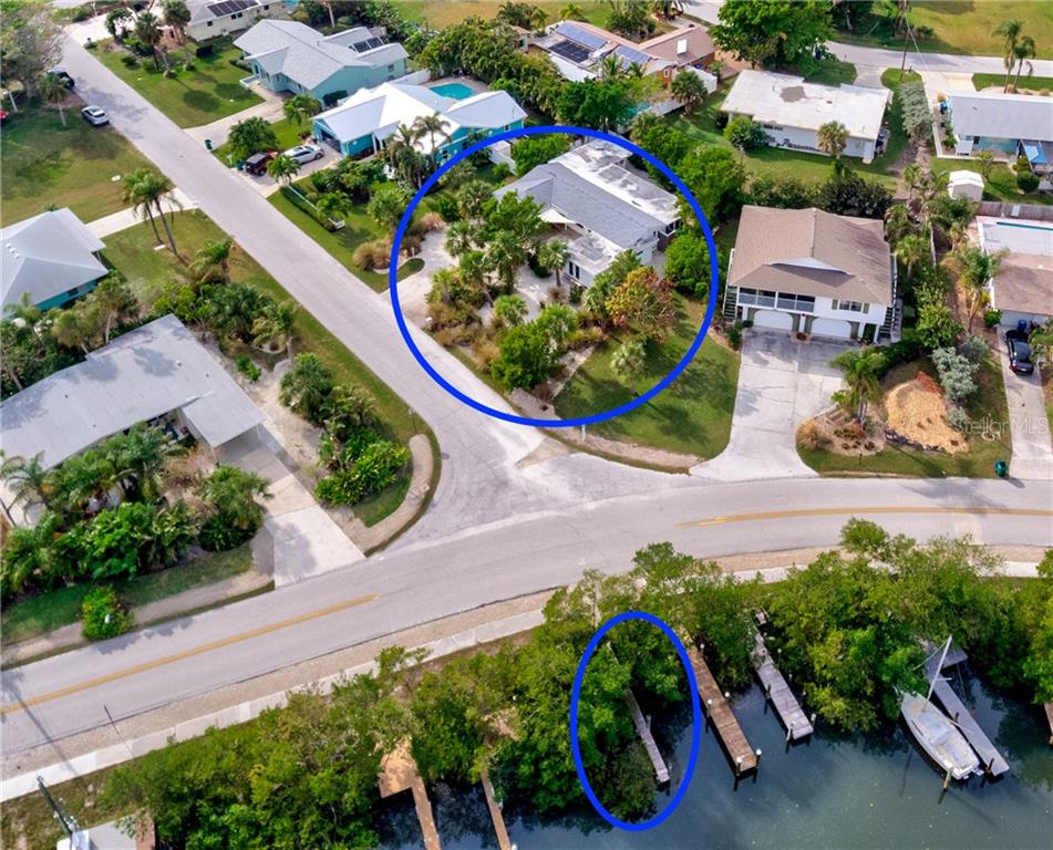 Aerial showing house and dock - Single Family Home for sale at 216 83rd St, Holmes Beach, FL 34217 - MLS Number is A4203519