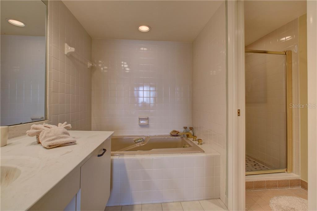 Master bath - Condo for sale at 5880 Midnight Pass Rd #610, Sarasota, FL 34242 - MLS Number is A4204670
