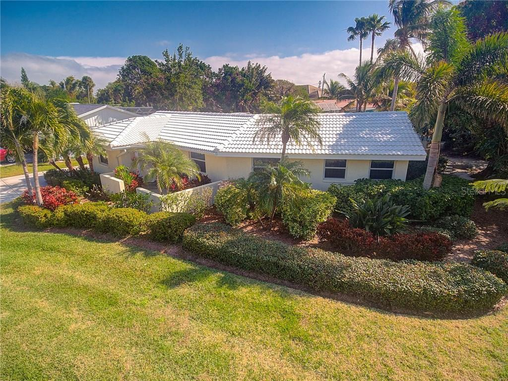 Experience island living with lush, tropical landscaping and your very own mango and orange trees! - Single Family Home for sale at 501 70th St, Holmes Beach, FL 34217 - MLS Number is A4205799