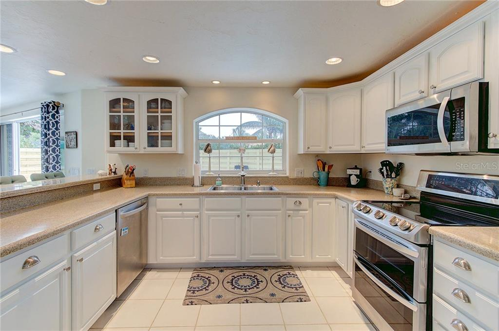 Updated coastal kitchen equipped with refinished cabinetry and stainless steel appliances and hardware. - Single Family Home for sale at 501 70th St, Holmes Beach, FL 34217 - MLS Number is A4205799