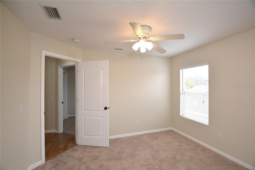 Bedroom 3 - Single Family Home for sale at 6320 Robin Cv, Lakewood Ranch, FL 34202 - MLS Number is A4205857