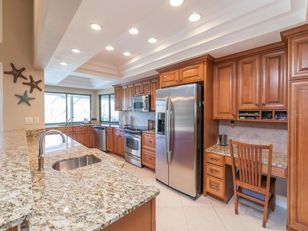 Beautiful Kitchen, with two sets of sliding windows to pool and spa area - Single Family Home for sale at 3959 Prairie Dunes Dr, Sarasota, FL 34238 - MLS Number is A4205907