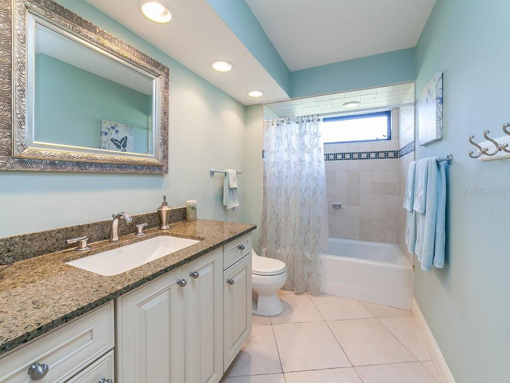 Guest Bath, with a sliding door nearby to the pool and spa area - Single Family Home for sale at 3959 Prairie Dunes Dr, Sarasota, FL 34238 - MLS Number is A4205907