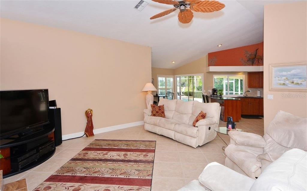 Family room looking into kitchen - Single Family Home for sale at 3882 Spyglass Hill Rd, Sarasota, FL 34238 - MLS Number is A4206477