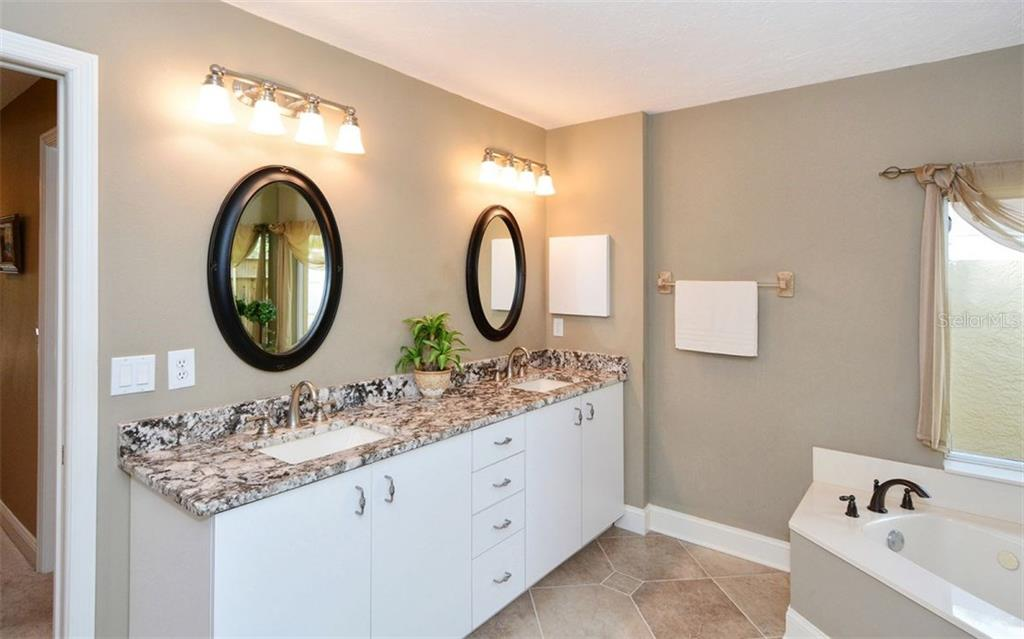 Master bathroom - dual sinks - Single Family Home for sale at 3882 Spyglass Hill Rd, Sarasota, FL 34238 - MLS Number is A4206477