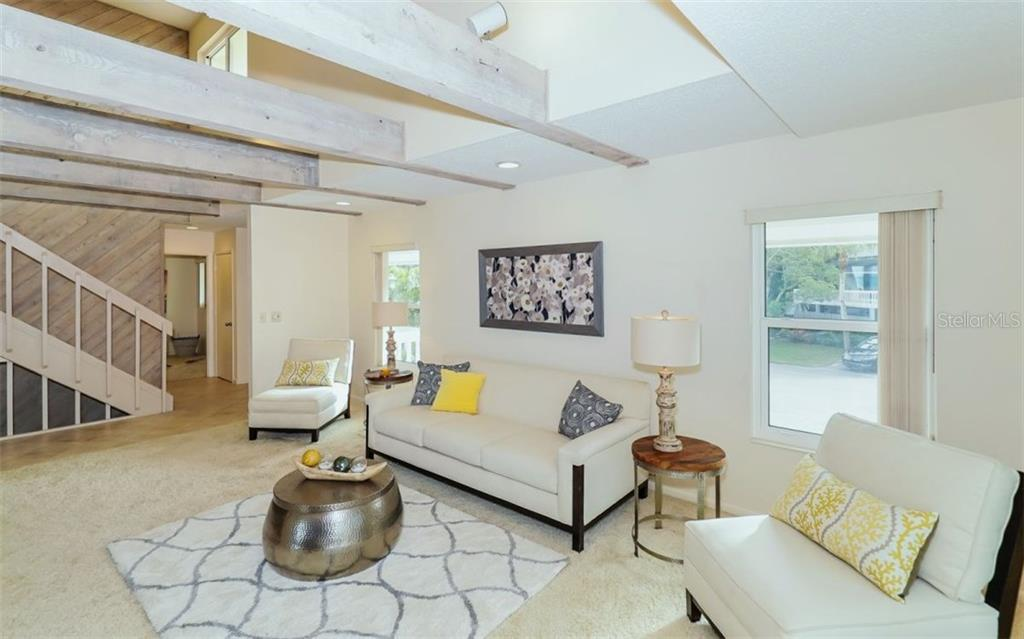 Living room - Single Family Home for sale at 148 Sand Dollar Ln, Sarasota, FL 34242 - MLS Number is A4206505