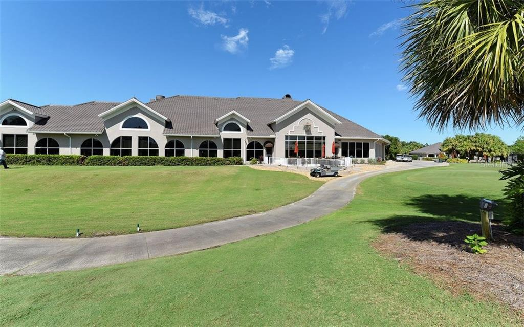Stoneybrook Golf & Country Club restaurant, pro-shop, back lanai.  Practice putting green is on the right. Tour #2 in this listing further highlights Stoneybrook. - Villa for sale at 9554 Forest Hills Cir, Sarasota, FL 34238 - MLS Number is A4206506