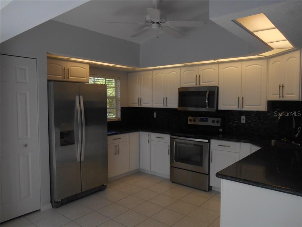 Chef's dream of a kitchen updated with stainless appliances!  There is a closet pantry as well! - Condo for sale at 815 Montrose Dr #202, Venice, FL 34293 - MLS Number is A4206556