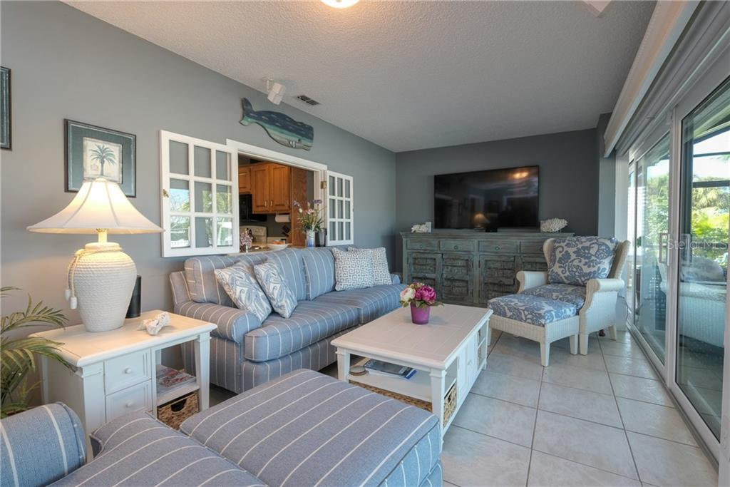 Family room with pass through from the kitchen. - Single Family Home for sale at 5633 Cape Leyte Dr, Sarasota, FL 34242 - MLS Number is A4207008